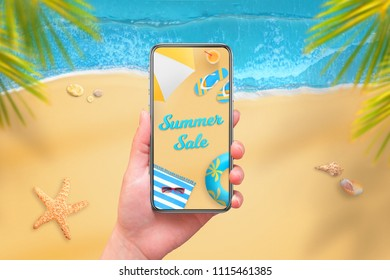 Summer sale on mobile phone display. Modern phone with round edges in woman hand. Beach and sea in background.