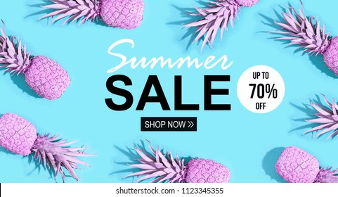 Summer sale with painted pineapples on a vivid blue background