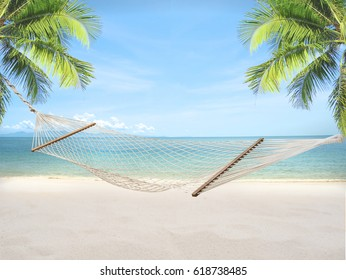 Summer sandy beach with hammock and coconut tree on blur ocean and sky background. concept vacation relax.