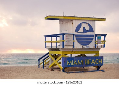 Summer scene in Miami Beach Florida, with a colorful lifeguard house in a typical Art Deco architecture, moments before sunrise with blue sky in the background. Light painting