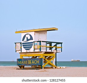 Summer scene in Miami Beach Florida, with a colorful lifeguard house in a typical Art Deco architecture, at sunset with blue sky in the background. Long exposure.