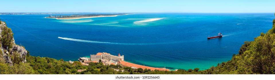 Summer sea coast landscape. Top view from Nature Park Arrabida in Setubal, Portugal. Three shots stitch high-resolution panorama.