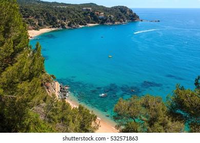 Summer sea sandy beach. Coastline between Barcelona and Palamos (Costa Brava, Catalonia, Spain).