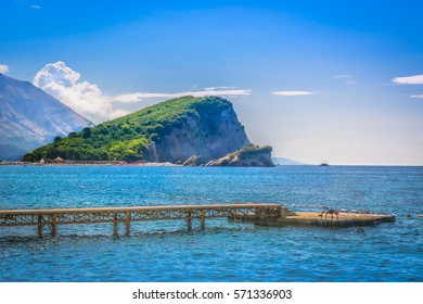 Summer seafront view at St. Nicholas Island near town Budva, famous travel resort in Montenegro, Europe. / Selective focus.