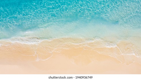 Summer seascape beautiful waves, blue sea water in sunny day. Top view from drone. Sea aerial view, amazing tropical nature background. Beautiful bright sea with waves splashing and beach sand concept - Shutterstock ID 1940936749
