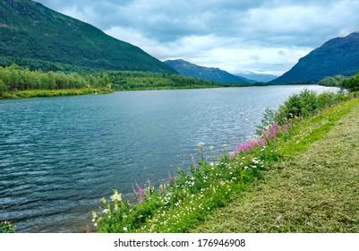 Summer Senja coast (Norway) view . Cloudy weather.