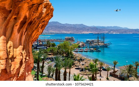 Summer serene day on central public beach of Eilat - famous resort and recreational city in the Middle East and Israel