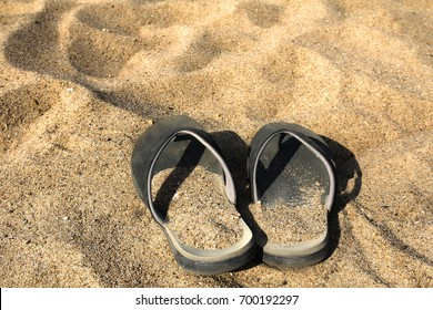 Summer shoes, beach sandals, Havaianas  in the sand