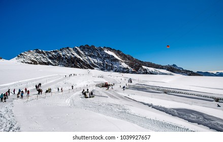 Summer skiing and hiking  on the glacier at Top Europe rail station Jungfraujoch, Switzerland.
