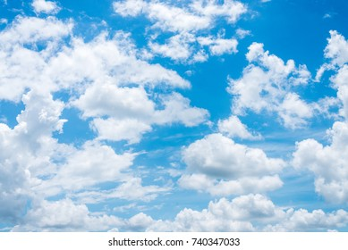 Summer sky and beautiful sun in the blue sky with clouds.