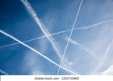 summer sky with condensation trails
