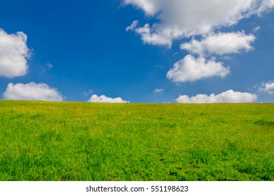 A summer sky taken over a green pasture in Cornwall, England