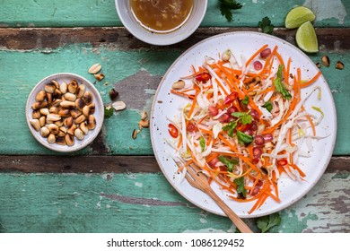 Summer Slaw Salad with Carrots, Cabbage, Bean Sprouts, Peanuts, Pomegranate.
