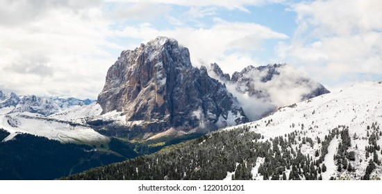 Summer snow on The Langkofel Mountain Group, Italian Dolomite. A view from Fermeda trail.