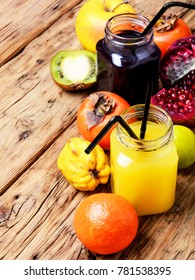 Summer soft juice from fresh fruit. Drink from apples, pomegranate, persimmons and kiwi