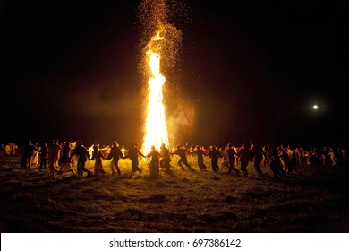 Summer solstice. Ivan Kupala - fest. Folk festival of the Eastern Slavs, dedicated to the summer solstice and the highest blossoming of nature. People dance fast around a huge fire. solar solstice