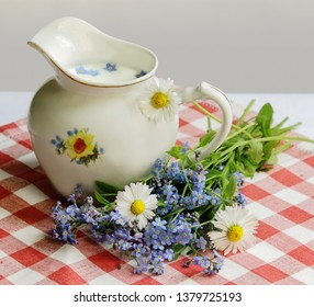 Summer still life: wild flowers and the milkman