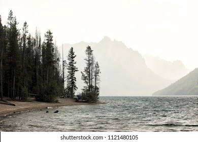 A summer storm brewing over Redfish lake in central Idaho, with overcast, high winds, and cool temperatures.