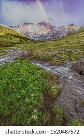 Summer storm clears with rainbow in San Juan Mountains, southwest Colorado