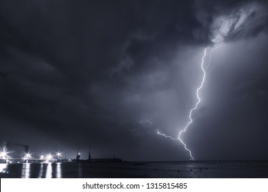 Summer storm, dramatic sky  and amazing lightnings over the ocean. natural background. black and white toned picture