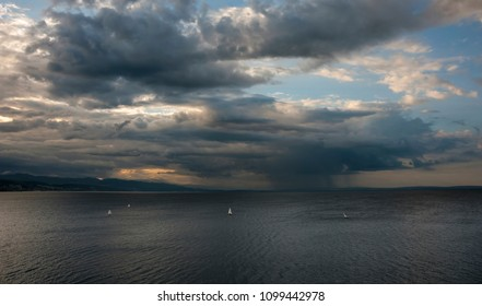 Summer Storm at the Sea with sailing boats sail through strong wind