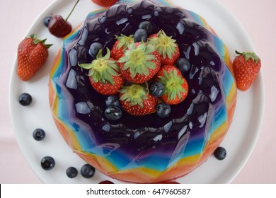 Summer strawberries and blueberries with rainbow Jello
