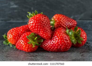 Summer strawberries on a dark background