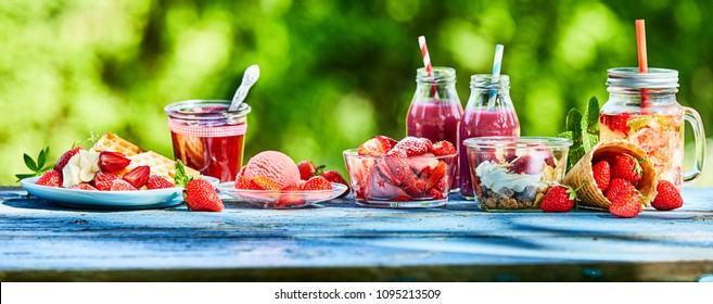 Summer strawberry garden food panorama banner. Delicious berry menus and desserts, punch bowl and ice cream and smoothies outdoors for advertising.