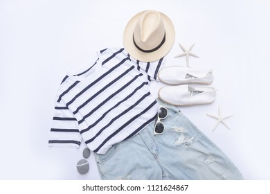 summer striped clothes collage on white with sunglasses,starfish, , hat, shoes ,stone, ,jeans on flat lay, top view