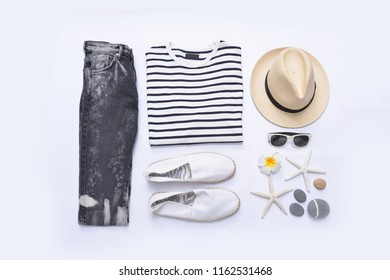 summer striped clothes collage on white with sunglasses, frangipani, hat, shoesstarfish, ,jeans on flat lay, top view