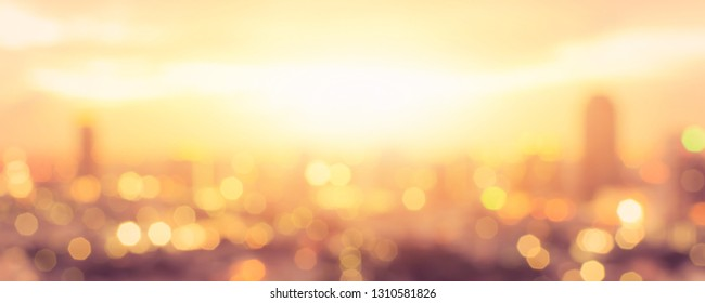 Summer sun blur golden hour hot sunset sky with city rooftop view  background cityscape office building landscape blurry urban warm bright lights skyline bokeh for evening party