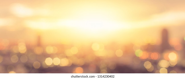Summer sun blur golden hour sky sunset with city rooftop view background cityscape office building cbd landscape blurry urban warm hot heat wave lights skyline polygon bokeh for evening night party