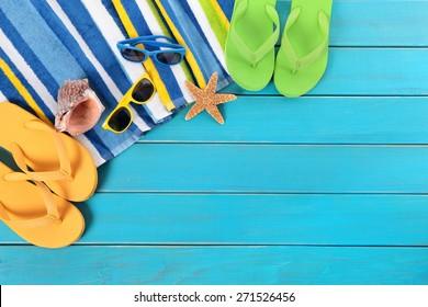 Summer sunbathing beach background, sunglasses, flip flops, copy space