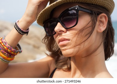 summer sunny fashion portrait of pretty young hipster girl wearing a hat  and sunglasses. Outdoors lifestyle portrait