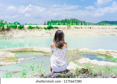 Summer sunny lifestyle fashion portrait of young woman traveling and posing at tubtai canyon huahin in prachuap khiri khan, Summer vacation time.