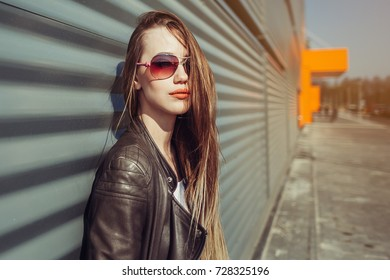 Summer sunny lifestyle fashion portrait of young stylish hipster blondie woman in sunglasses walking on street,wearing cute trendy outfit, smiling enjoy weekends