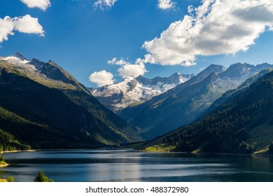 Summer sunny scene in the valley of Speicher Durlassboden lake in the Austrian Alps. View from Gerlos pass, Austria, Europe.