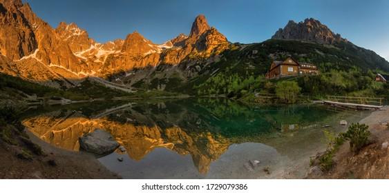 Summer sunrise at an alpine hut in the High Tatras, Zelene pleso, Pysny stit.