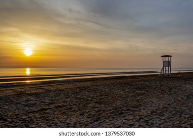 Summer sunrise at an empty sandy Senigallia beach with a lifeguard tower, Province of Ancona, Marche, Italy