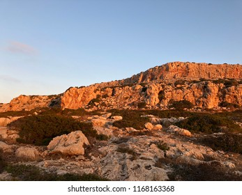 The summer sunrise on the abrupt rock of the island of Cyprus   similar american's canyon