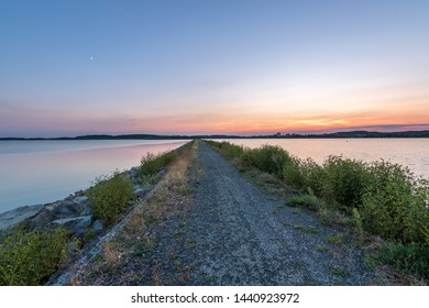 Summer sunset by the lake, color sky, way to the water. Rozkos, Czech republic - Shutterstock ID 1440923972