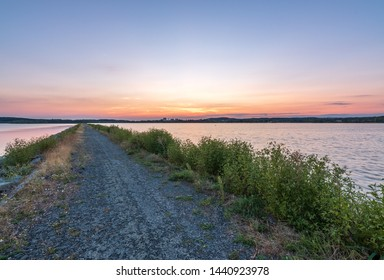 Summer sunset by the lake, color sky, way to the water - Shutterstock ID 1440923978