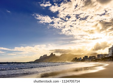 Summer sunset with cloudy sky with Two Brothers hill and view from Ipanema beach at Rio de Janeiro