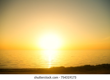 Summer sunset landscape on the sea shore