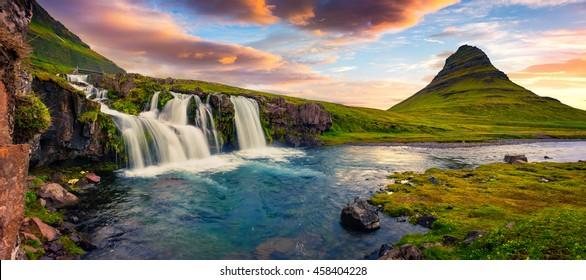 Summer sunset on famous Kirkjufellsfoss Waterfall and Kirkjufell mountain. Colorful evening panorama of Snaefellsnes peninsula, Iceland, Europe. Artistic style post processed photo.