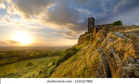Summer sunset over Brentor, with the church of St Michael de Rupe - St Michael of the Rock, on the edge of the Dartmoor National Park, Devon, UK