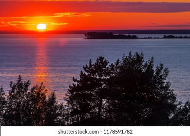 Summer sunset over the Ob sea. District of Berdsk, the confluence of the two rivers Berdi and Ob, Novosibirsk region, Western Siberia, Russia