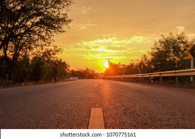 summer sunset over rural road in Thailand.