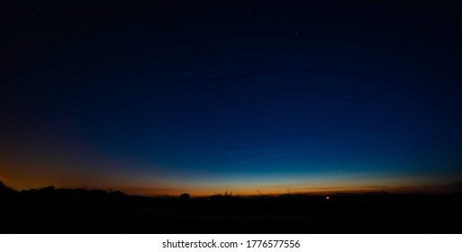 Summer sunset panorama with Comet C / 2020 F3 NEOWISE over the horizon in Spain