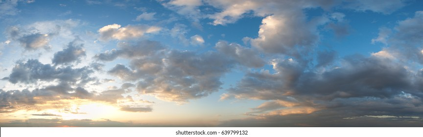 Summer sunset sky panorama with fleece clouds. Summer evening good weather background. Five shots high-resolution stitch image.